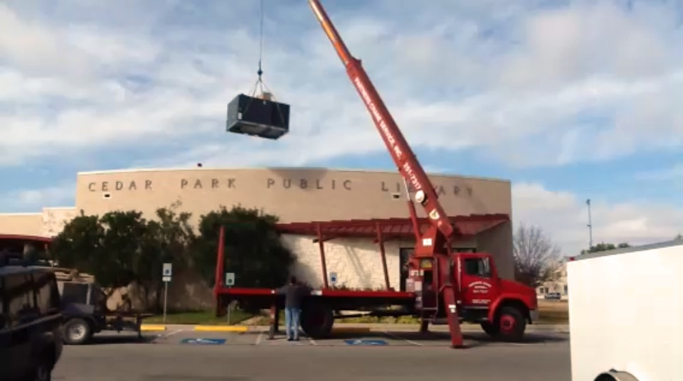 Arise Services installing a new packaged unit at Cedar Park Library.
